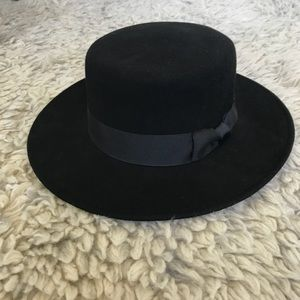 Lack of color round black wool hat